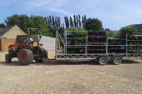 A trailer full of plants being transported to the Finishing Centre