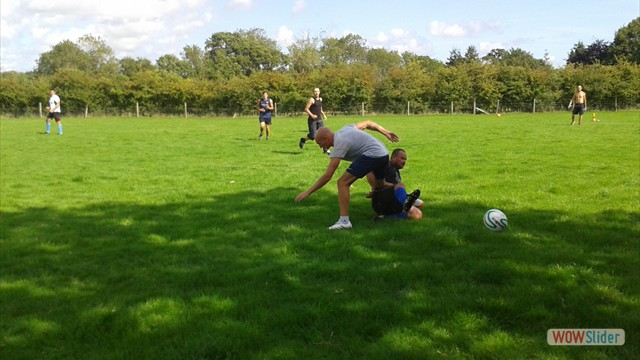 Simon slides in for a tackle